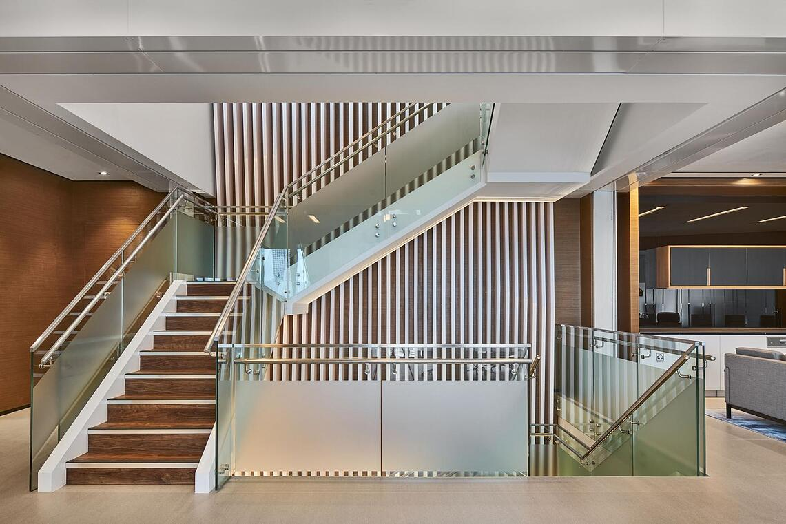 Beautiful internal staircase made of wood, glass and metal.